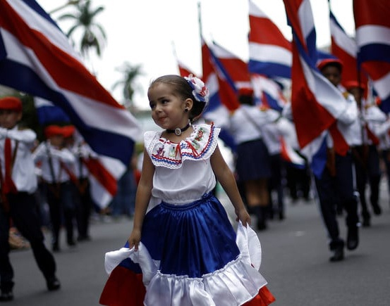 Girl dancing in parade for Independence